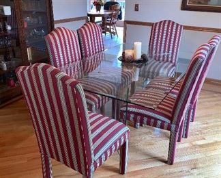 Glass table w/glass top and legs & 6 stripped upholstered chairs - chairs can be sold separate from the table