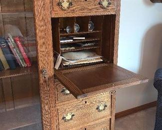 Vintage Oak Bookcase w/drop down door for office supply storage.