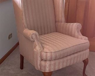 1 of 2 matching stripped wing back chairs