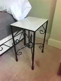 One of two marble side tables