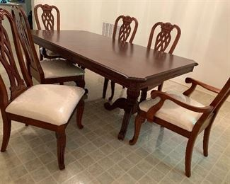 2 pedestal table with 1 leaf.  Seats six