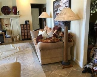 Living room area - Sofa, Matching tall lamps, oil painting, pottery items