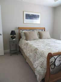Queen bed with boxspring and mattress.