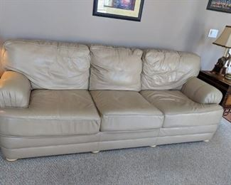 $100  Tan leather sofa  (as is, leather is cracked)