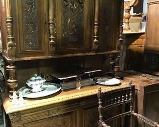 Carved Hunt cabinet