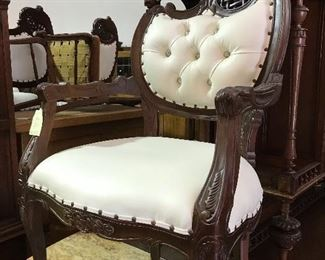 Carved mahogany chairs- one of several