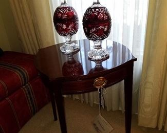 "Kindel ""Winterthur Collection"" table (one of two available) displaying ruby cut-to-clear covered compotes"