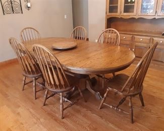 Oak Amish dining room table with two leaves and 8 chairs