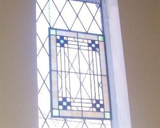 THERE ARE SEVERAL PIECES OF STAINED GLASS