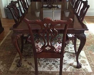 Thomasville Mahogany Dining Room Table and Chairs - Mahogany banded top table Chippendale style includes two 20″ skirted leaves that extend the table to 116″. The feet are carved ball and claw.  Rug is also for sale