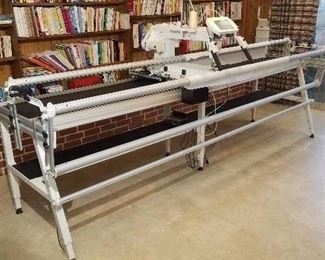 PFAFF Grand Quilter 18.8  Set Up -  There are no signs the machine was ever used.  Length 120 inches  Depth.     35 inches Height top bar 42 inches Height top of Grand Quilter Screen 54 inches