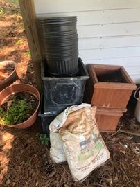 Tons of empty pots and gardening items