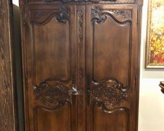 Armoire with carved angels