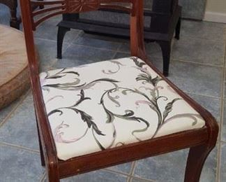 One of two chairs that go with the table