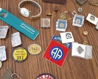 Variety of pins and badges from Ford Motor Company and others