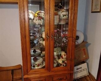 nice mirrored display cabinet filled with franciscan ware