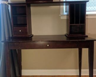 Solid wood desk with a hutch and a folder organizer thingy. Small drawer for a keyboard I think (haha do people even use those anymore?) Target.  It is from 2000, so it's seen some things, but it's sturdy. Could be sanded and restained.
