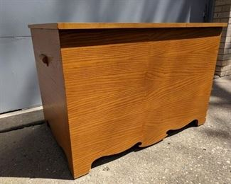 Toy chest, handmade.  Arms were used too.  And legs.  Er- ok, it was man-made.  By a man with tools.
