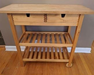 Chefs cart.  Old and loved, like your grandma.  Use in the garage or for potting plants.  (Unlike your grandma.)