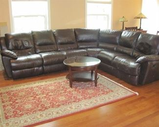 Leather Sectional Sofa with Electric Recliners, Area Rug, Round Glass Top Accent Table