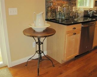 Wrought Iron Base Round Wood Top Table, Wash Basin and Pitcher,  Large Glass Barrell Bottle, Glass Storage Bottles