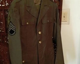Army Uniform.  Right sleeve has 'age-holes' above patch.