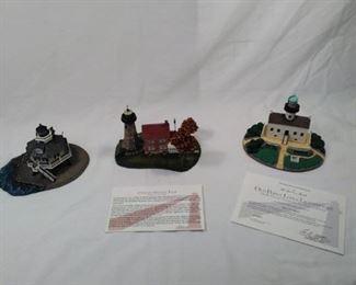 lot of 3 porcelain Danbury Mint Lighthouses . Charlotte Genesee light, Hooper Strait light , and Old Point            https://ctbids.com/#!/description/share/152071