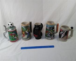 lot of 5 Budweiser and Worldcup collector steins . including golf, basketball, and bowling    https://ctbids.com/#!/description/share/152099