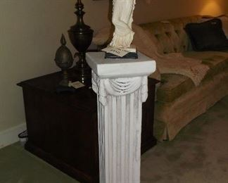 One of a pair of decorative columns  and lady statue,