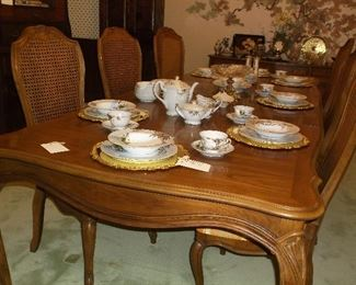 French style dining table and eight chairs w/cane backs