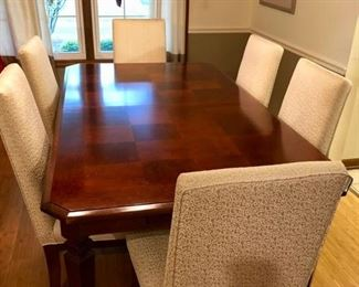 Gorgeous Dining table and six upholstered chairs, in great shape.  The tabletop almost looks like parquet, but very cool and different!