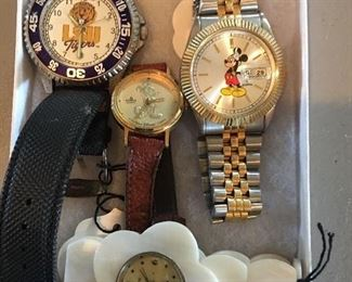 Collection of Watches    -Men's LSU Watch    - Men's Mickey Mouse Watch    - Woman's LSU Watch    - Sweet YLQ Watch