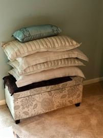 Pillows and linens, including a storage ottoman