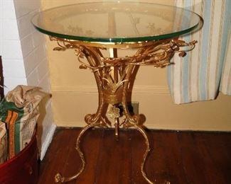 Floral and glass table $200