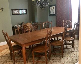 "Beautiful ""custom made"" oak dining table with 8 matching chairs."