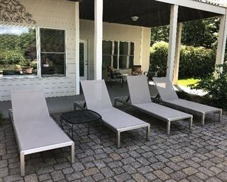 Very Nice, four sleek loungers, backs are adjustable, also have wheels on two legs for easy moving!                          Black metal table