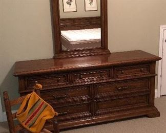 Long dresser with matching mirror, small child's rocker.