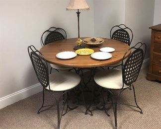 Nice heavy metal table with four matching chairs.