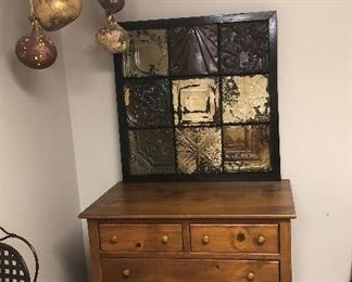 Hartford House 5 drawer chest, has a top matching piece for hanging clothes. We will have a picture of it soon.  Also painted gourds, and tin picture.