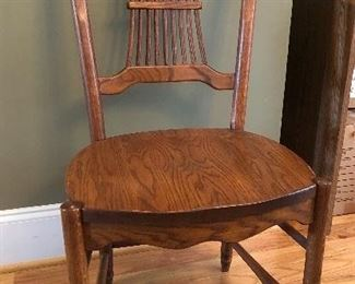 One of eight custom crafted chairs