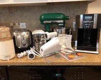 Sunbeam Oskar Chopper, Krups toaster , Mr. Coffee, Green Kitchen Aid Mixer with many attachments including  Food Grinder, Rotor Slicer/Shredder/ Graters plus more