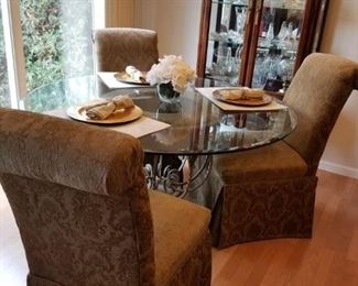 Glass dining table With four upholstered chairs available  Chairs $110 each