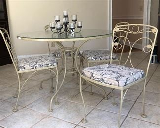 Vintage metal table with 4 matching chairs.