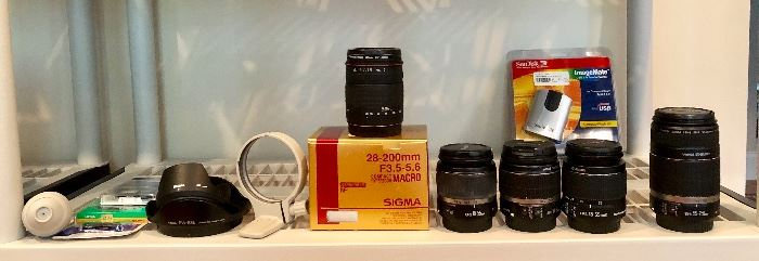 Canon and Hoya filters, Sigma Merkury Optics 62mm UV 28-200mm lens, Canon EFS 18-55mm lens (x2), Canon EFS 18-55mm lens Image stabilizer, Canon EFS 55-250mmZoom lens, San Disk Image Mate