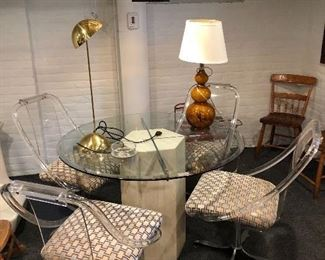 Round glass table and lucite chairs