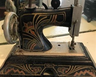 Child's tin sewing machine