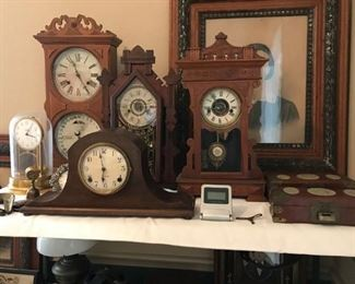 Large selection of antique clocks, 2 Waterbury Clocks both working, 2 Session Mantle Clocks, 1 working,  1 Ithica Calendar Clock, non working, and 1 Tiffany neverwind clock, the dome is cracked.