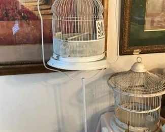 Iron stand with vintage bird cage