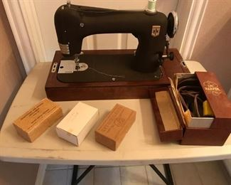 Montgomery Ward sewing Machine with case and accessories from the 1940's.