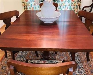 Solid Mahogany, Pedestal Dining Room Table with two additional leaves for seating of 8-10. 8 Dining Chairs with custom upholstery.